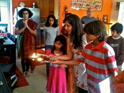 Mudita Bahadur performs an offering with her children, Nadeen, 11, and Nikita, 9, before the Bal Kendra group breaks for social hour. RNS photo courtesy Santa Monica Bal Kendra