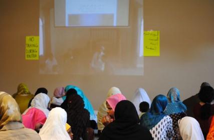 Women listen to the sermon at the Islamic Center of Spokane