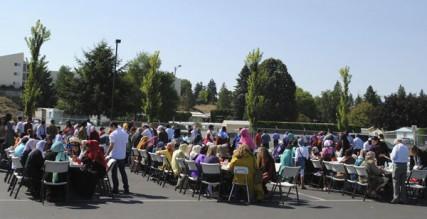 Many join in an Eid-al-Fitr potluck.