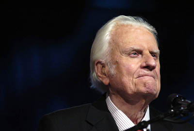 Evangelist Billy Graham preaches to a crowd of more than 17,000 people at the New Orleans Arena during the ``Celebration of Hope'' hosted by the Billy Graham Evangelistic Association and Samaritan's Purse Sunday, March 12, 2006.