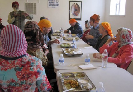 Faith Feast guests learn about Sikhism while eating an entree at the Sikh Gudwara of Spokane.
