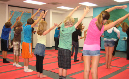 Children practice yoga at El Camino Creek Elementary School in Carlsbad, Calif.