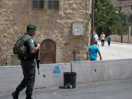 A young IDF soldier patrolling Shuhada St in Hebron