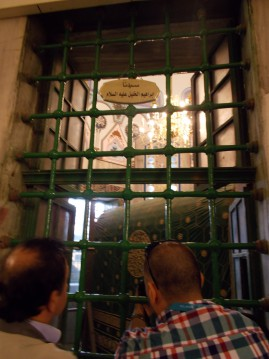 Peeking in to see Abraham from the Muslim side of the Tomb of the Patriarchs
