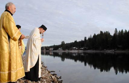 Members of the Antiochian Archdiocese bless the Spokane River. Tracy Simmons/SpokaneFAVS