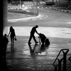A janitor cleans the sidewalk/Ghenady - Wikimedia