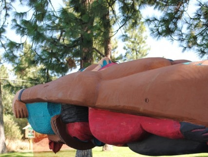 A 19-foot totem pole rests on a flat bed as it makes its way through Spokane/Tracy Simmons - SpokaneFAVS