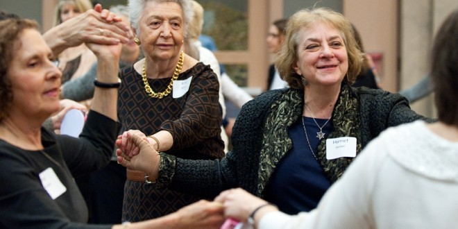 (RNS2-march25) Women dance during the sisterhood/zhava annual women's seder at Congregation Beth El of Montgomery County in Bethesda, Md., on Sunday, March 22, 2015.For use with RNS-WOMEN-SEDAR, transmitted on March 25, 2015, Religion News Service photo by Sait Serkan Gurbuz
