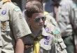 (RNS1-may29) A Boy Scout marches with his troop during the Memorial Day parade in Smithtown, N.Y., May 27. For use with RNS-BOY-SCOUTS, transmitted on May 29, 2013, RNS photo by Gregory A. Shemitz.