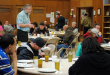 Rev. Alan Eschenbacher visits with guests at a Tuesday Night Dinner at All Saints Lutheran/Tracy Simmons - SpokaneFAVS file photo