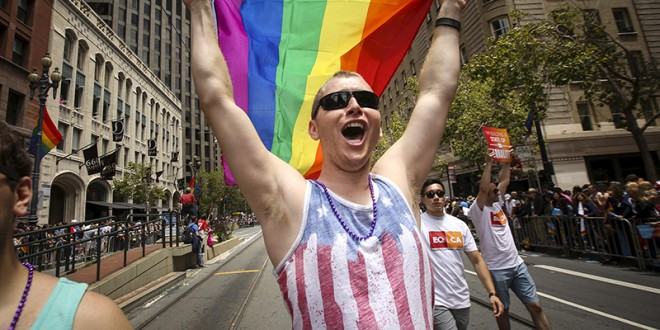 A man waves a rainbow flag while marching in the San Francisco gay pride parade two days after the U.S.  Supreme Court's landmark decision that legalized same-sex marriage throughout the country in San Francisco, Calif., on June 28, 2015. Photo courtesy of REUTERS/Elijah Nouvelage *Editors: This photo may only be republished with RNS-ABORTION-MARRIAGE, originally transmitted on July 2, 2015.