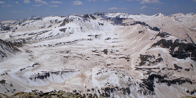 A photograph of the extreme dust deposition from the deserts of the Colorado Plateau onto the Colorado Rockies snowpack in 2009. Taken from the high point of the Senator Beck Basin in the San Juan Mountains, it captures the extent of the impact of darkening in which the snow albedo dropped to about 30%, more than doubling the absorption of sunlight. Credit: S. McKenzie Skiles, Snow Optics Laboratory, NASA/JPL.