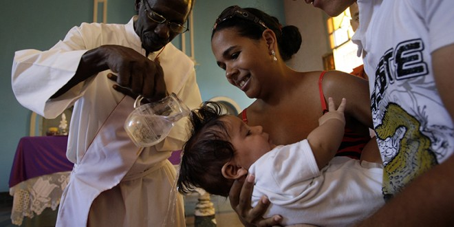 A child is baptized at a Catholic church in Havana on March 18, 2012. Photo courtesy of REUTERS/Stringer *Editors: This photo may only be republished with RNS-VATICAN-GODFATHER, originally transmitted on September 3, 2015.