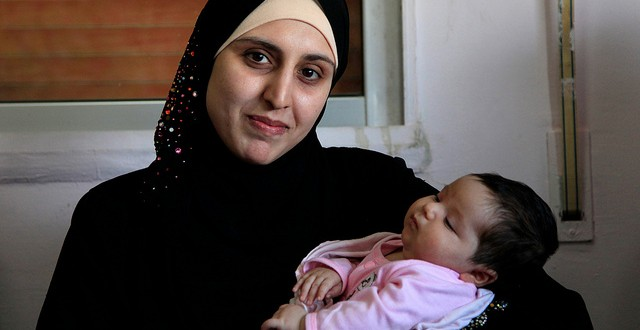 A Syrian refugee and her newborn baby at a clinic in Ramtha, Jordan/Photo by Russell Watkins/Department for International Development