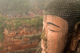 Giant Buddha sculpted into the cliff at Leshan Flickr photo by Chi King