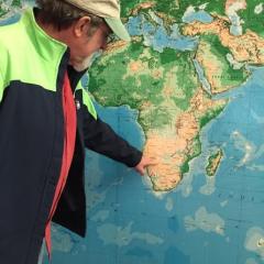 Paul Rodkey points to a map/Lindsey Treffry - SpokaneFAVS
