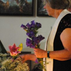 Rev. Toni Niemiec of the Center For Spiritual Living lights a candle at an Interfaith Pride Service/Tracy Simmons - SpokaneFAVS