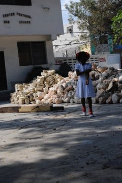 A young girl dressed for Sunday church in Haiti not long after the 2010 earthquake/Tracy Simmons