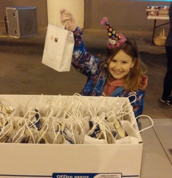 Handing out goodie bags at Blessings Under the Bridge