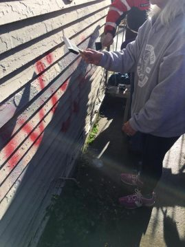 Children help paint over graffiti at the MLK Center in Spokane/Contributed photo